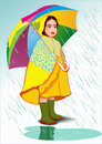 Little girl under umbrella in raincoat standing in the rain Royalty Free Stock Photos