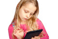 Little girl using ebook reader Stock Image