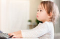 Little girl using her computer Royalty Free Stock Photo