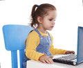 Little girl using laptop isolated stock image portrait of a cute horizontal shot on white Stock Photography