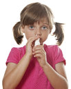 Little girl using nasal spray Royalty Free Stock Photo