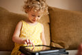 Little girl using tablet computer cute Royalty Free Stock Image