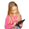 Little girl using a touch screen computer on white background Royalty Free Stock Images