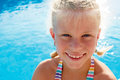 Little girl vacationers beside swimming pool in a portrait of sunny summer day Stock Photo