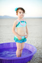 Little Girl Vintage Bathing Suit in Plastic Pool Royalty Free Stock Photography
