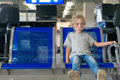 Little girl waiting for flight. Royalty Free Stock Photo