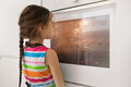 Little girl waiting near the kitchen oven for homemade cookies Royalty Free Stock Photo