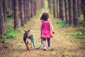 Little girl walking with dog