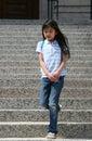 Little girl walking down  steps Stock Photo