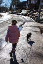 Little girl walking a little dog Royalty Free Stock Photo