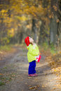 Little girl walking in the oak grove she looks up Royalty Free Stock Photo