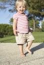 Little girl walking in park Royalty Free Stock Photo