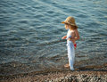 Little girl walking on a pebbly beach beautiful Royalty Free Stock Photography