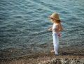 Little Girl Walking On A Pebbl...