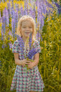 Little girl walks on blossoming meadow beautiful smiling in late summer Stock Photography