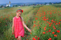 Little girl walks in the poppy field Royalty Free Stock Photo