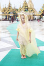 Little girl walks round the Shwedagon pagoda Royalty Free Stock Image