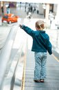 Little girl walks on walkway alone the track to move people Stock Photos