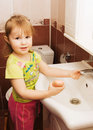 The little girl washes hands Stock Image