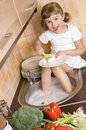 Little girl washing dishes Stock Images