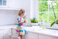Little girl washing dishes Royalty Free Stock Photo