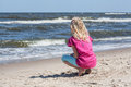 Little girl watching waves on a beach sea Stock Photo