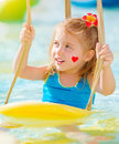 Little girl on water attractions closeup portrait of sweet with red heart print cheek having fun summer holiday joy and Stock Photos