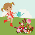 Little girl watering the flowers outdoor Royalty Free Stock Images