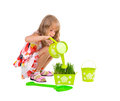 Little girl watering grass smiling isolated on white Royalty Free Stock Image