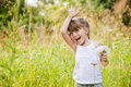 Little girl waving high outdoor Stock Photos