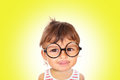 Little girl wearing black glasses looking at camera