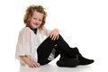 Little girl wearing boots sitting with white background Royalty Free Stock Image