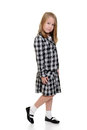 Little girl wearing checkered dress on white background Stock Photo