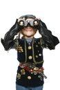 Little girl wearing costume of pirate looking away through the binoculars Royalty Free Stock Photo