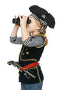 Little girl wearing costume of pirate looking away through the binoculars Royalty Free Stock Images