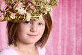 Little girl wearing flower wreath with pink curtain background Stock Images