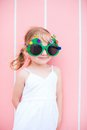 Little girl wearing funny Christmas glasses Royalty Free Stock Photo