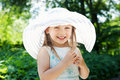 Little girl wearing a hat outdoors at the park Stock Photography