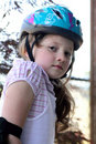 Little girl wearing helmet Stock Photography