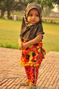Little girl wearing hijab muslim in traditional pakistani clothes Stock Photo