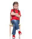 Little girl wearing red t-short and posing on chair Stock Image