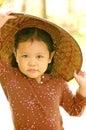 Little girl wearing wooden hat vietnamese style 库存照片