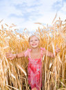 Little girl in a wheat field Royalty Free Stock Photo