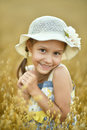 Little girl in wheat field Royalty Free Stock Photo