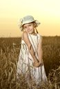 Little girl in the wheat field Royalty Free Stock Photo