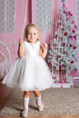 Little girl white christmas fir tree Royalty Free Stock Photos