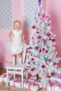 Little girl white christmas fir tree Stock Photos
