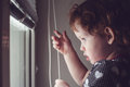 Little girl on the window blinds open kid Royalty Free Stock Image