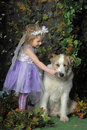 Little girl with wings and a dog portrait of her butterfly her Stock Images