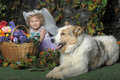 Little girl with wings and a dog portrait of her butterfly her Royalty Free Stock Photo